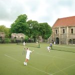 British and international high school exchange students playing tennis at a British private boarding school in England