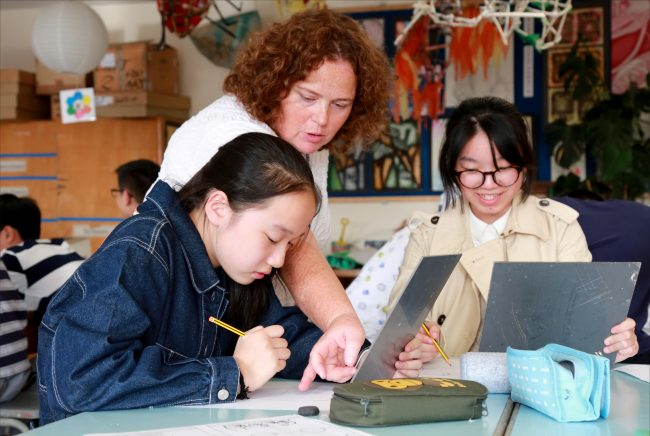 Chinese students enjoying art class in British high school