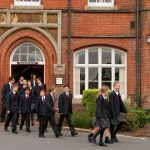 British and international exchange students walking together in school in England