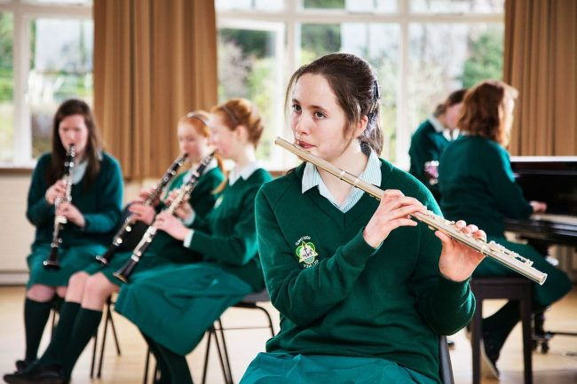 Girls playing music at high school in Ireland