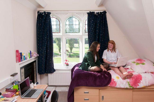 Irish student and exchange student share dormitory in Irish boarding school
