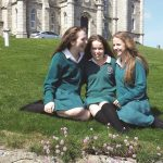 Students relax outside during break time at school in Ireland