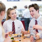 Exchange students having lunch with Irish students at school in Ireland