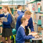 Irish students and exchange students doing research in school library in Ireland